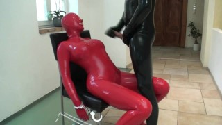 Abused Rubber Whore In Red Latex Catsuit And Mask Bounded Slapped Pissed